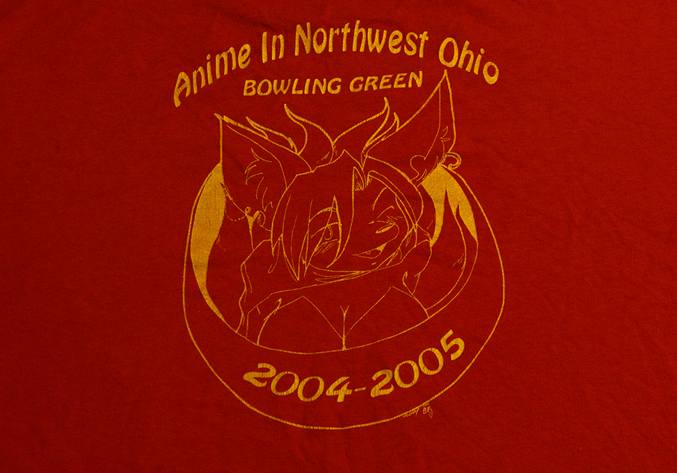 The back of the 2004 Anime In Northwest Ohio tee shirt. The front graphic is the same as the 2003 tee shirt.