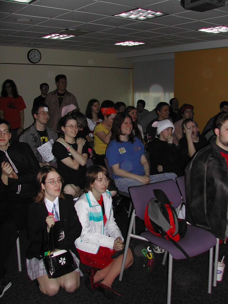 A screening at Animarathon III. Many guests are posing for the camera.